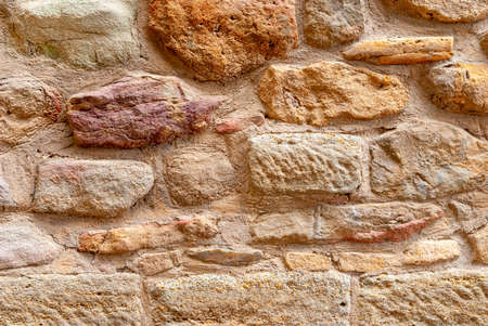 Ancient walls and laying of old stones. Texture background for design. Reklamní fotografie