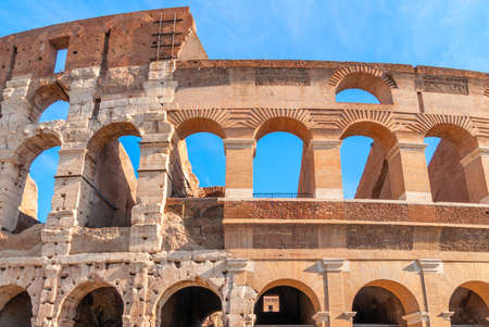 Colosseum in Rome, Italy. Ancient Roman Colosseum is one of the main tourist attractions in Europe. People visit the famous Colosseum in Roma center. Scenic nice view of Colosseum ruins in summer.