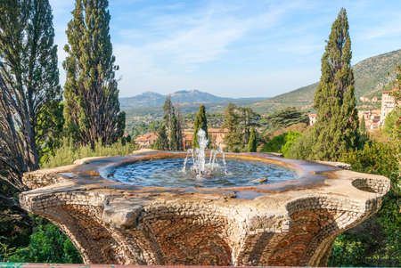 Antique historic fountain, iconic landmark in Villa dEste, Tivoli, Italy.