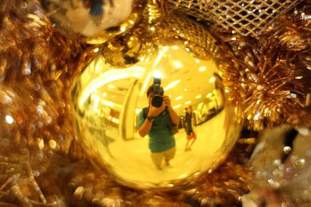 reflect: reflect of golden christmas ornament