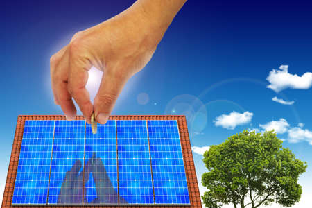 photovoltaic: House with solar energy and wind turbine to make money and protect the planet earth.