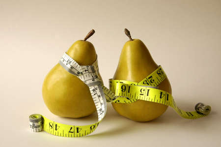 carbs: Two pears with measuring tape tie and belt.