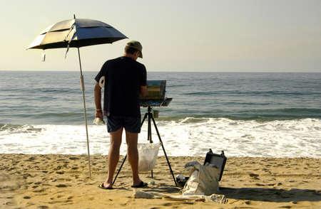 Painter takes advantage of the beach Stock Photo - 285954