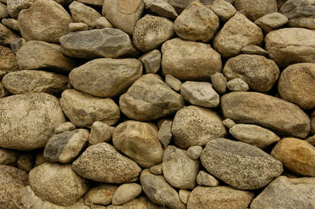 Close up of a rock wall with no binding cement