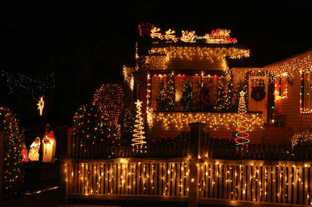 sled: A home with x-mas lights galore in Christmas celebration.