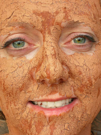 Woman with detoxifying mud on her face 版權商用圖片