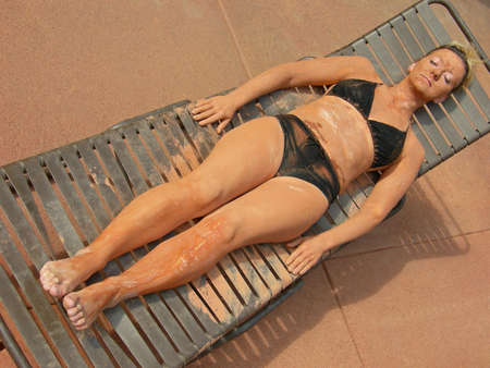 assimilate: Woman reclines with mud treatment at a spa.