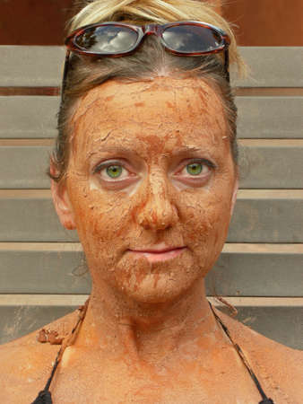 Woman relaxes as she gets a pampering facial