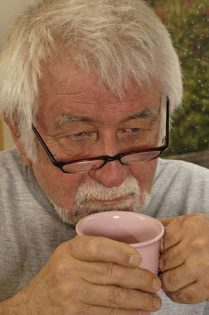 reminisce: Man contemplates and drinks his morning coffee