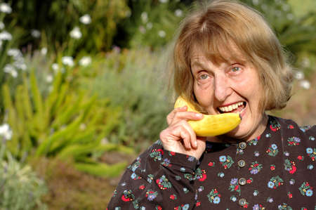Older woman talks into banana instead of phone