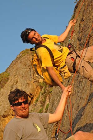 belay: Two Men Rappel off Mountain in Southern California Stock Photo