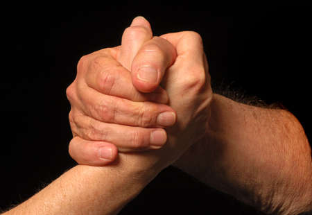 Two people meet and shake hands photo