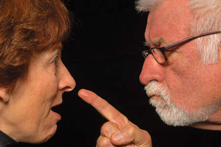 impasse: MAn and woman fight and point blame
