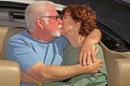 Couple kissing in back seat of car photo