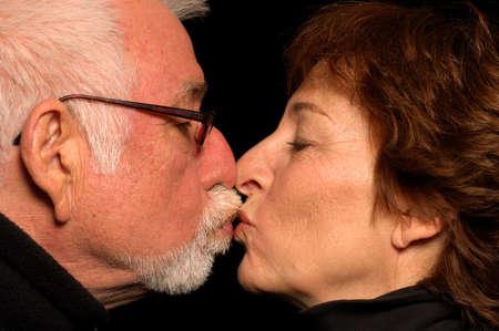 Older couple in love kisses