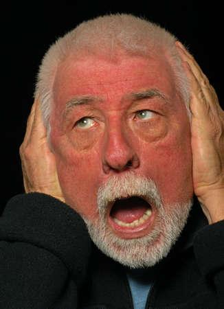 loud noise: Man covers ears from loud noise