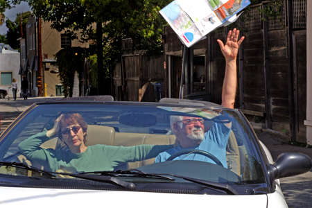 Frustrated man throws map out the car photo