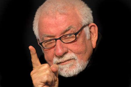 Older man point finger in warning Imagens