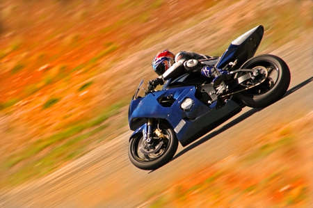junky: A lightening quick motorcycle rider speeds by