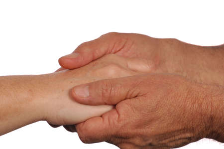 basic care: Man holds womans hand tenderly Stock Photo