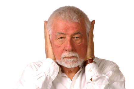 impasse: Man hold both ears closed