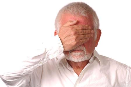 impasse: Man in white shirt covers eyes
