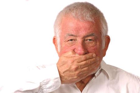 impasse: Man covers mouth, wont talk Stock Photo