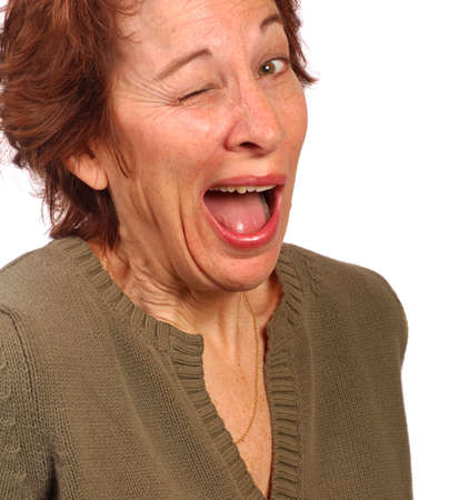 makes: WOman makes a funny face, winking Stock Photo