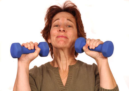 Woman struggles with two 5 lbs. weights Stock Photo