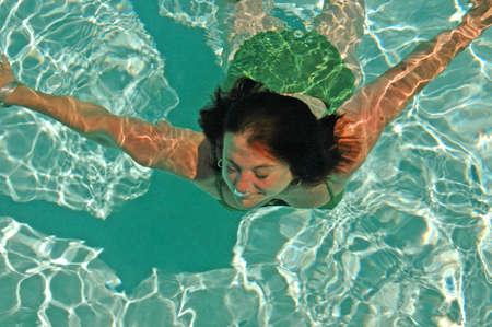 Woman floats underwater in ecstasy