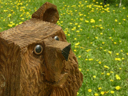 freaked: Wood sculpture of a bear with a goofy expression
