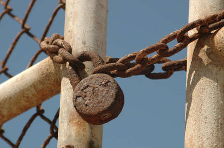 An old rusted lock & chain says Stock Photo - 416717