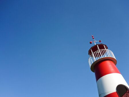Red and white lighthouse photo