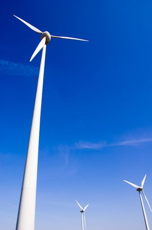 Wind generator against blue sky
