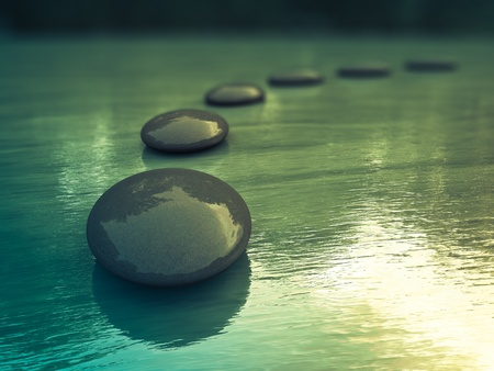 spirituality therapy: Black zen stones  on a sea