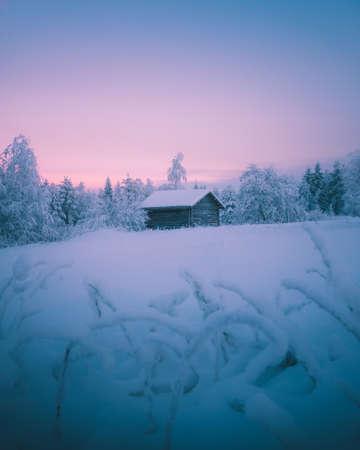 Snowy barn in beautiful winter scene in Kuhmo, Finland