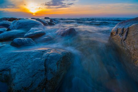 Wild sea in sunset