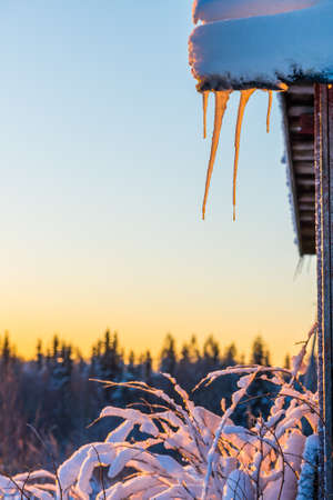 Icicles on old countryside building
