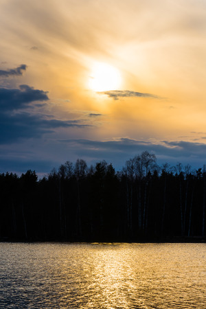 Sunny spring evening lake landscape Stock Photo