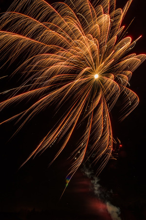 Golden firework explosion Stock Photo