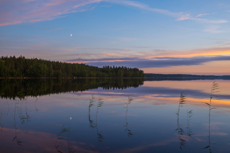 Summer night landscape at Finnish calm blue lake Stock Photo