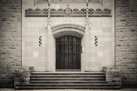 Wooden cathedral door in shot black and white photo