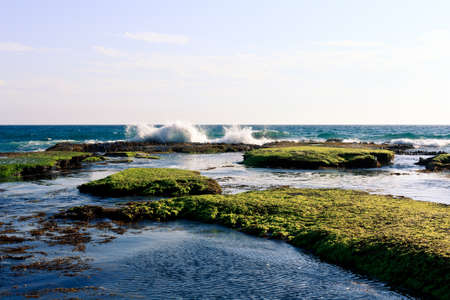 sorrento: Wave splashing upon the edge of the rocky shore at Portsea beach Melbourne Stock Photo