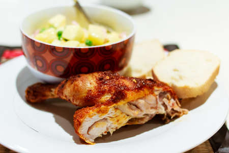 Quarter roast chicken served with potato salad and bread Stock Photo - 12927060