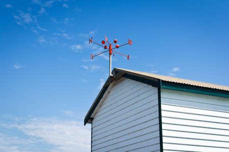 wind vane: red wind vane at the roof top
