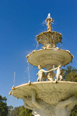 tier: large multi tier water fountain with water splashing and flowing down the sculpture facade Stock Photo