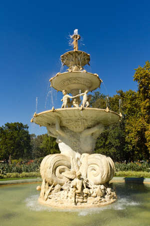 large multi tier water fountain with water splashing and flowing down the sculpture facade Stock Photo - 13218900