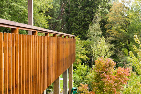 Stock Photo   Wooden Fencing Of Outdoor Patio Overlooking Alot Of Trees And  Plants On An Autumn Day