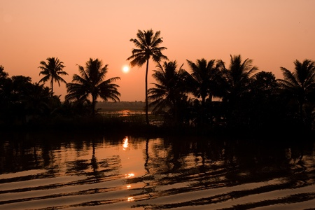 In Kerala, India, a colorful sunset on the backwaters photo