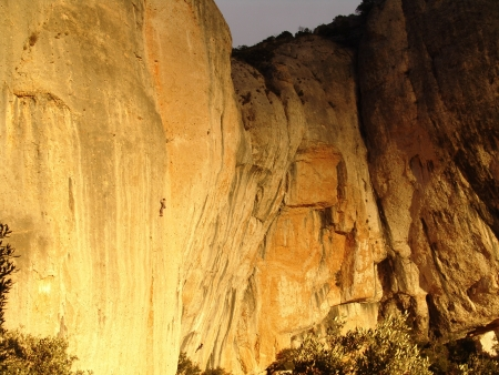 A rock climber is on a cliff in Montsarra photo